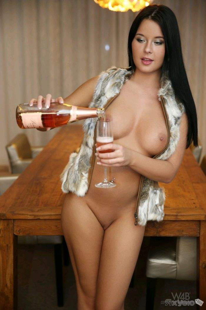 Naked girls drinking wine